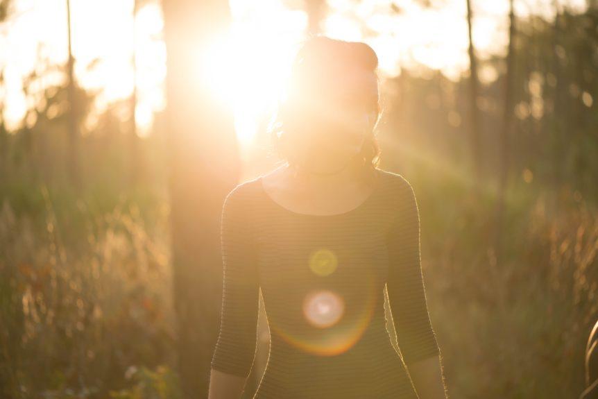 Modern Mystery School Woman in forest in Light